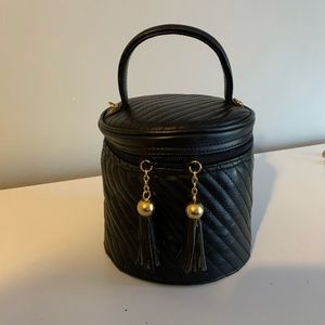 Vintage 90s quilted vinyl mini bag with tassels